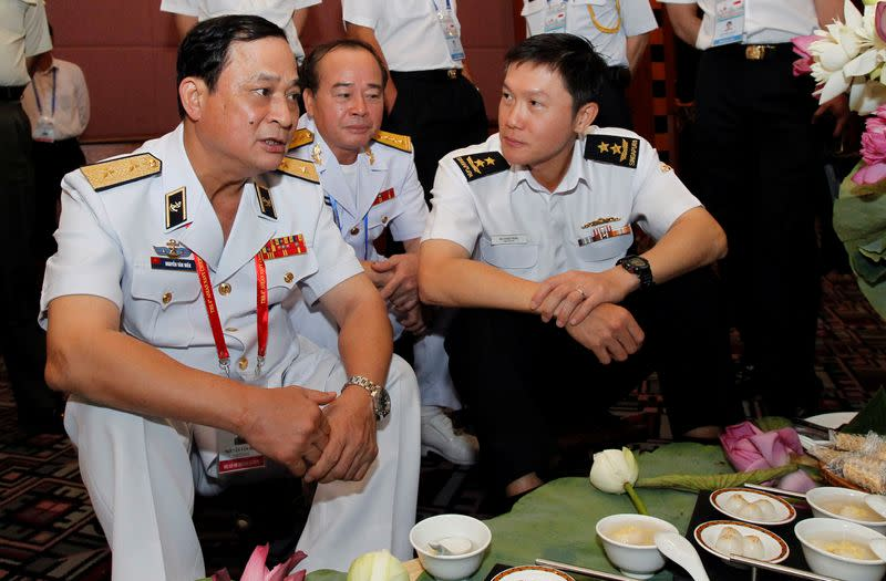 FILE PHOTO: Vietnam's Vice Defence Minister and Navy Commander in Chief Vice Admiral Nguyen chats with Singapore's Navy Chief Rear Admiral Ng along the sides of the 5th ASEAN Navy Chiefs meeting in Hanoi
