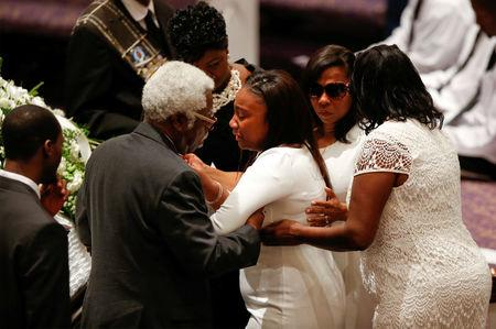 REFILE - ADDITIONAL CAPTION INFORMATIONKeirra LaNae Scott (C), daughter of police shooting victim Keith Scott, mourns with family members during his funeral at the First Baptist Church in James Island, South Carolina, U.S. October 14, 2016. REUTERS/Randall Hill