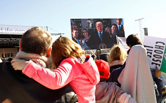 <p>Particpants watch as President Donald Trump speaks by satellite from the nearby White House to attendees of the March for Life anti-abortion rally in Washington, Jan. 19, 2017. (Photo: Eric Thayer/Reuters) </p>