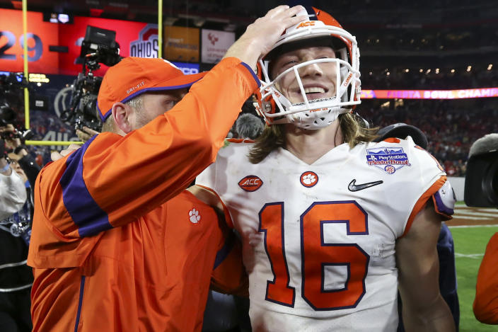 Clemson quarterback Trevor Lawrence (16) is congratulated after Clemson defeated Ohio State 29-23 in the Fiesta Bowl NCAA college football playoff semifinal Saturday, Dec. 28, 2019, in Glendale, Ariz. (AP Photo/Ross D. Franklin)