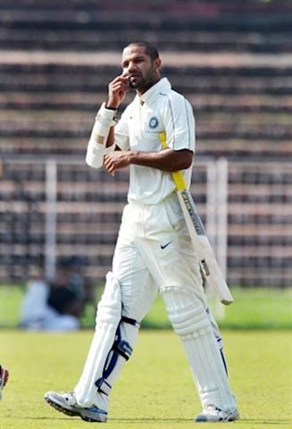 Shikhar Dhawan walks out of the ground after a ball hit him on the face during the final day of the three-day practice cricket match between Australia and Indian Board President's XI in Chandigarh on September 27, 2010. AFP PHOTO/Dibyangshu SARKAR