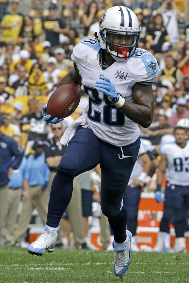 FILE - In this Sept. 8, 2013 file photo, Tennessee Titans running back Chris Johnson (28) runs during the third quarter of an NFL football game against the Pittsburgh Steelers in Pittsburgh. The Titans have told Chris Johnson they are releasing him after six seasons to avoid paying the $8 million the running back is due in pay in 2014, and the final three seasons left on the $53.5 million contract he signed in September 2011. The Titans announced Johnson has been told he will be released Friday, April 4, 2014. (AP Photo/Gene J. Puskar, File)