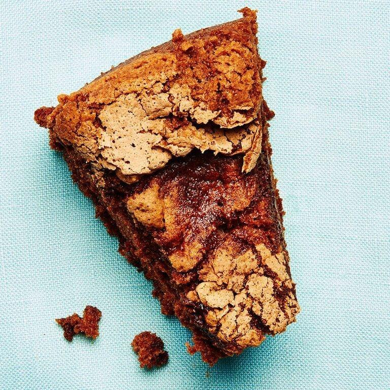 """<strong>Grandma's Chocolate Cake With Coffee</strong><br>Yield: 1 cake<br><br><strong>Gabrielle Laub:</strong> <em>""""Confession, I have never made this. My Nana is good at everything ,though, obviously, because she's queen in my book. Have you ever been disappointed when coffee and cake get together to make sweet dessert-love? Didn't think so.""""</em><br><br><strong>Ingredients</strong><br>1 cup of sugar<br>4 egg yolks<br>1 cup sifted flour<br>1 tbsp baking powder<br>4 egg whites<br>1/2 cup cocoa powder<br>1/2 cup hot coffee<br><br><strong>Instructions</strong><br>1. Preheat oven to 325ºF.<br><br>2. Mix cocoa powder with hot coffee.<br><br>3. Beat the sugar and egg yolks until smooth.<br><br>4. Add chocolate and coffee mixture.<br><br>5. Add sifted flour and baking powder.<br><br>6. In a separate bowl, beat egg whites until stiff. Fold into rest of mixture.<br><br>7. Bake in a <a href=""""http://www.amazon.com/Cuisinart-AMB-9TCP-Classic-Nonstick-Bakeware/dp/B0000D8CAN"""" rel=""""nofollow noopener"""" target=""""_blank"""" data-ylk=""""slk:tube pan"""" class=""""link rapid-noclick-resp"""">tube pan</a> for approximately 30 minutes.<span class=""""copyright"""">Photographed by Ted Cavanaugh; Food Styling by Claudia Ficca.</span>"""