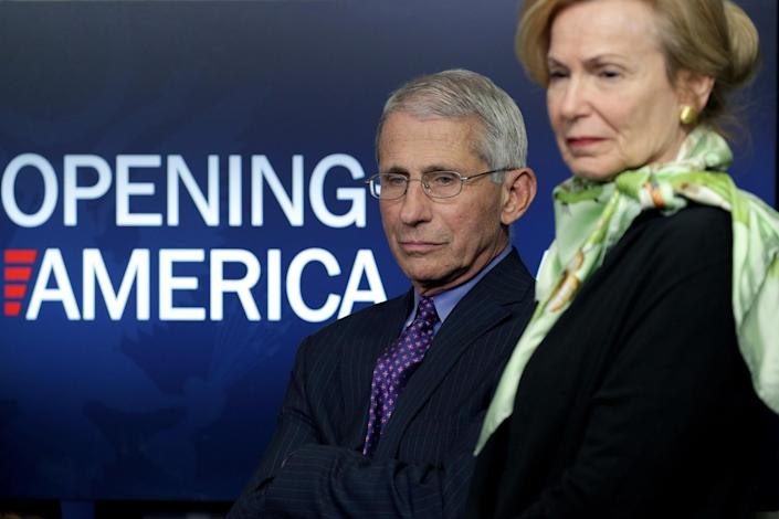 Drs. Anthony Fauci and Deborah Birx listen to President Trump speak at the daily briefing of the coronavirus task force on April 16. (Alex Wong/Getty Images)