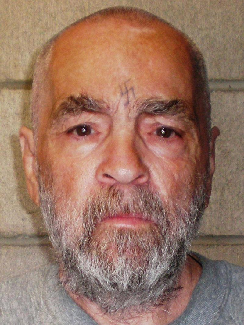 Charles Manson pictured in 2009, his face still bearing the scar of a swastika he carved into his forehead decades earlier (California Department of Corrections and Rehabilitation via Getty Image)
