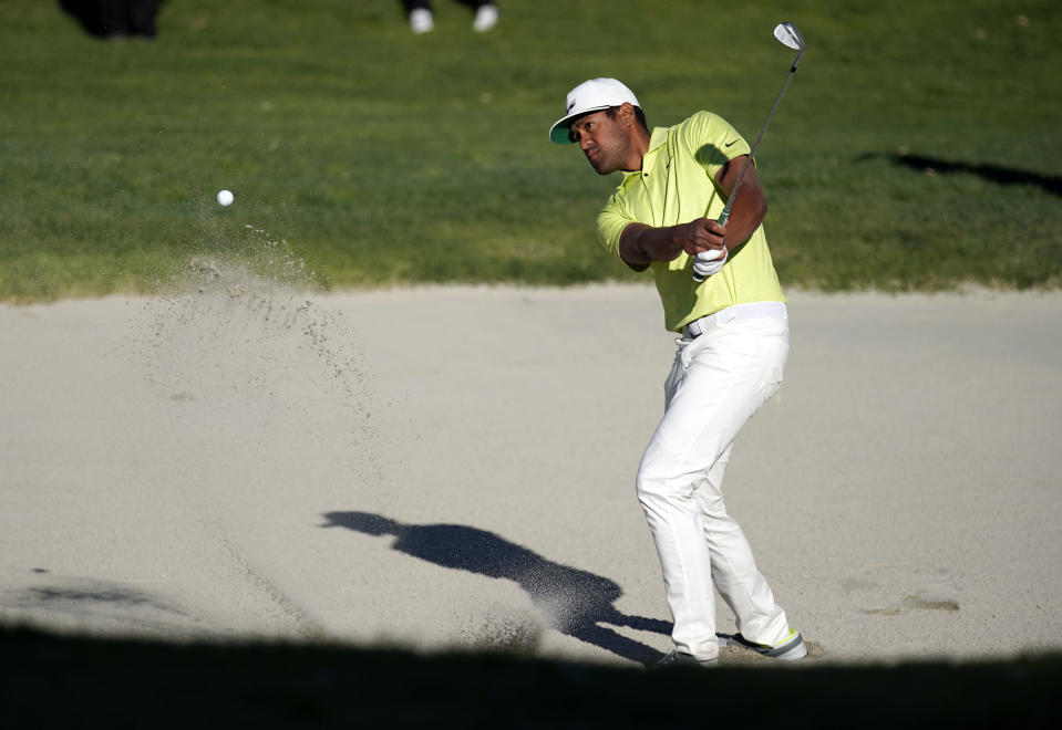 Tony Finau hits his second shot out of the bunker on the 14th hole during a playoff against Max Homa in the final round of the Genesis Invitational golf tournament at Riviera Country Club, Sunday, Feb. 21, 2021, in the Pacific Palisades area of Los Angeles. (AP Photo/Ryan Kang)