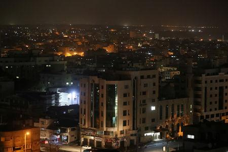 A general view of Gaza City at night March 14, 2019. REUTERS/Mohammed Salem