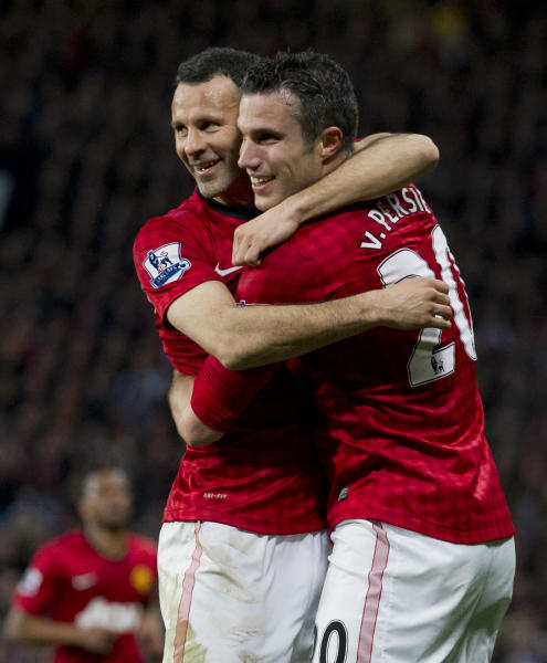 Manchester United's Robin van Persie, right, celebrates with teammate Ryan Giggs after scoring his third goal against Aston Villa during their English Premier League soccer match at Old Trafford Stadium, Manchester, England, Monday April 22, 2013. (AP Photo/Jon Super)