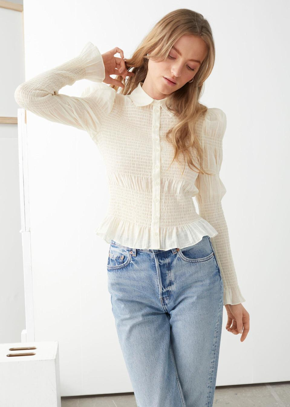 <p>This <span>Fitted Smocked Shirt</span> ($99) is pure elegance.</p>