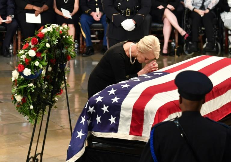 Cindy McCain, wife of John McCain, prays at the casket of her husband at the US Capitol Rotunda in Washington