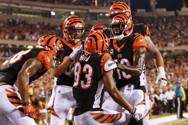 Cincinnati Bengals wide receiver Tyler Boyd (83) celebrates with wide receiver A.J. Green (18) and his teammates after scoring a touchdown in the first half of an NFL football game against the Baltimore Ravens, Thursday, Sept. 13, 2018, in Cincinnati. (AP Photo/Frank Victores)