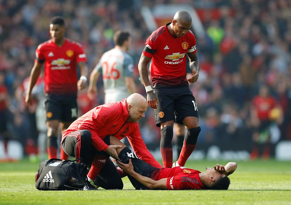 Manchester United's Jesse Lingard receives treatment from the physio after suffering an injury during the English Premier League clash with Liverpool. (PHOTO: Reuters/Phil Noble)