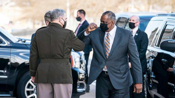 PHOTO: Mark Milley, Chairman of the Joint Chiefs of Staff, greets incoming Secretary Of Defense Lloyd Austin III outside of the Pentagon on Austin's first day in his new role  in Arlington, Va., Jan. 22, 2021. (Sarah Silbiger/Getty Images)