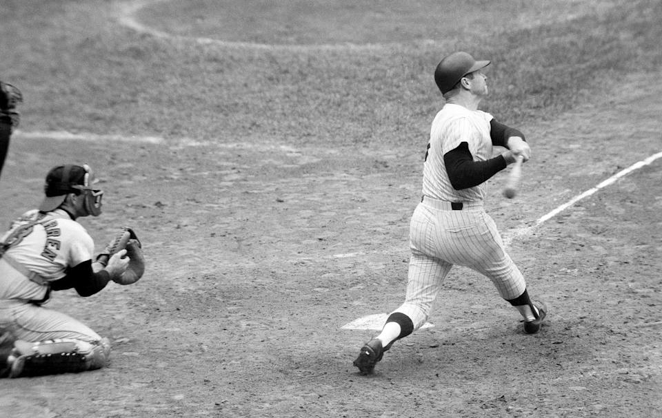 Mickey Mantle follows through on the 500th home run of his career in 1967.