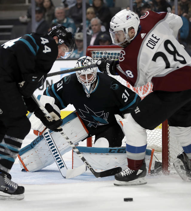 San Jose Sharks' Marc-Edouard Vlasic, left, and goalie Martin Jones (31) defend against Colorado Avalanche's Ian Cole (28) during the second period of an NHL hockey game Friday, March 1, 2019, in San Jose, Calif. (AP Photo/Ben Margot)