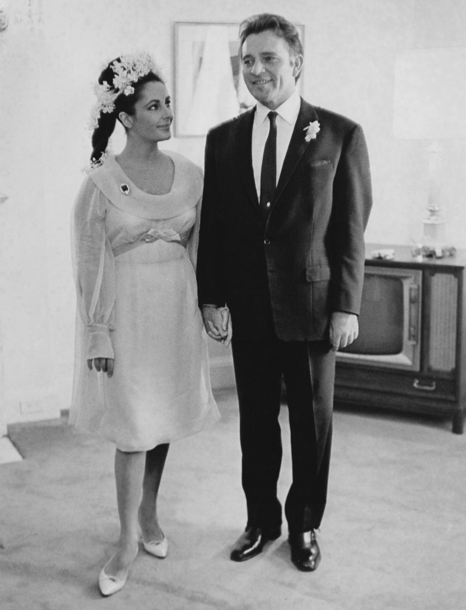 """<p>Taylor and Burton's fiery romance dominated headlines after the pair met while filming """"Cleopatra"""" in 1962. They married in 1964 and divorced a decade later. Despite their notoriously tumultuous relationship, the two remarried in 1975 - but their reconciliation would last less than a year. <em>(Image via Getty Images)</em></p>"""