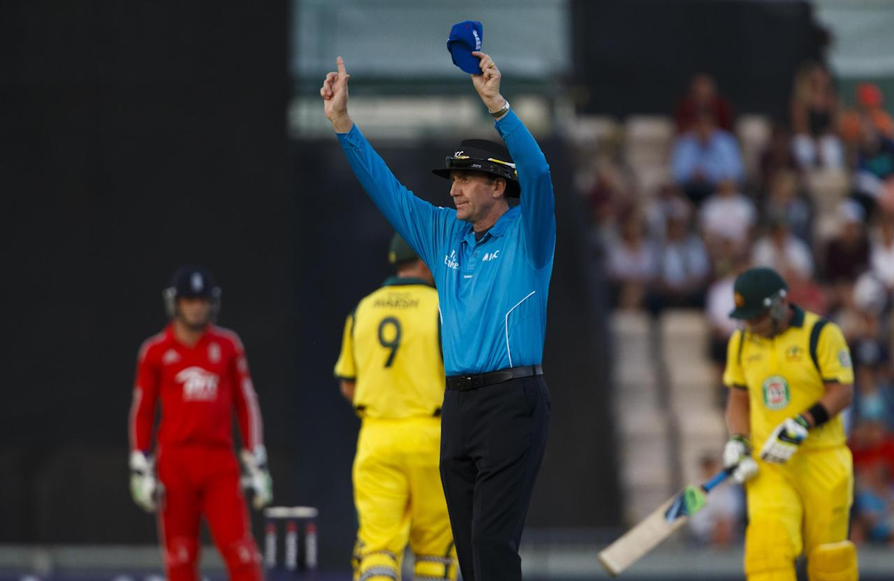 Umpire Rob Bailey signals another six for Australia's Aaron Finch during the International Twenty20 match at the Ageas Bowl, Southampton.