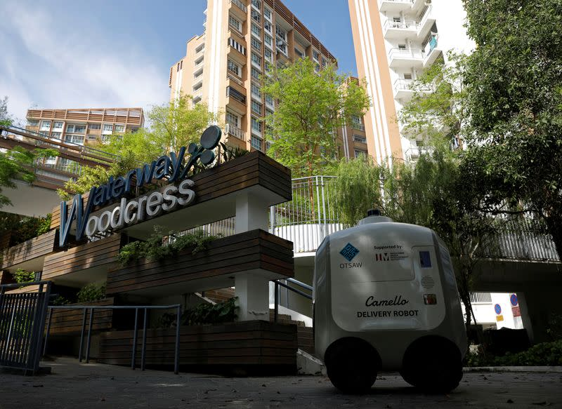 Carmello, an autonomous grocery delivery robot, makes its way during a delivery in Singapore
