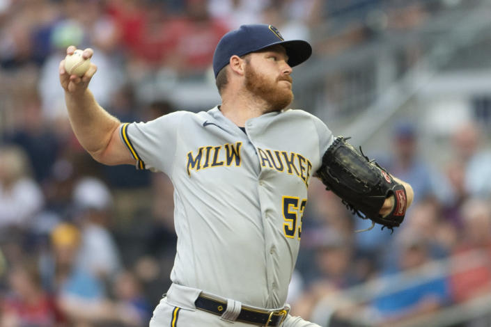 Milwaukee Brewers starting pitcher Brandon Woodruff throws against the Atlanta Braves during the first inning of a baseball game Saturday, July 31, 2021, in Atlanta. (AP Photo/Hakim Wright Sr.)