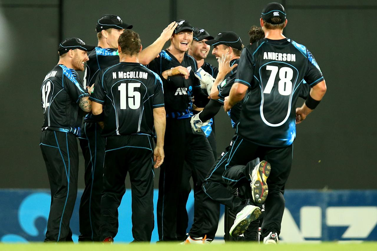AUCKLAND, NEW ZEALAND - JANUARY 11:  Martin Guptill of New Zealand celebrates his catch of Andre Russell of the West Indies during the first T20 between New Zealand and the West Indies at Eden Park on January 11, 2014 in Auckland, New Zealand.  (Photo by Phil Walter/Getty Images)