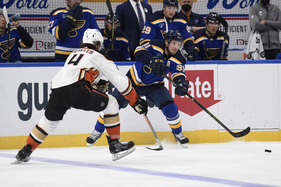 Anaheim Ducks' Cam Fowler (4) attempts to block a pass from St. Louis Blues' Vladimir Tarasenko (91) during the second period of an NHL hockey game Friday, March 26, 2021, in St. Louis. (AP Photo/Joe Puetz)