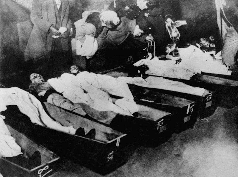 FILE - In this March 1911 file photo, family members try to identify the dead victims of the Triangle Shirtwaist factory fire of March 25, 1911 in New York.  One hundred years ago, horrified onlookers watched as workers leapt to their deaths from the raging fire in the garment factory. The fire killed 146 workers, mainly young immigrant women and girls, and became a touchstone for the organized labor movement, spurred fire-safety laws and shed light on the lives of immigrant workers. (AP Photo/File)