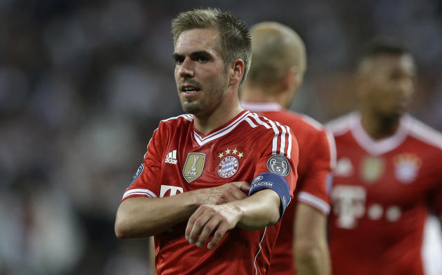 Bayern's Philipp Lahm takes off his armband after a Champions League semifinal first leg soccer match between Real Madrid and Bayern Munich at the Santiago Bernabeu stadium in Madrid, Spain, Wednesday, April 23, 2014. (AP Photo/Paul White)