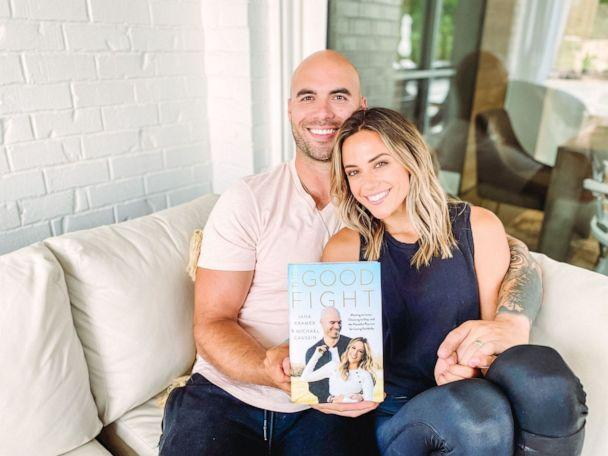 PHOTO: Jana Kramer and husband Michael Caussin are seen holding a copy of their book 'The Good Fight.' (Kristin Barlowe)