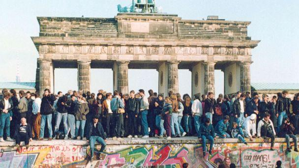 PHOTO: In this Nov. 10, 1989, file photo, Germans from East and West stand on the Berlin Wall in front of the Brandenburg Gate in Berlin. (AP, File)