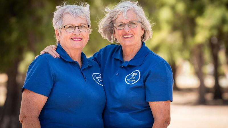 Twin sisters recognised for charity work