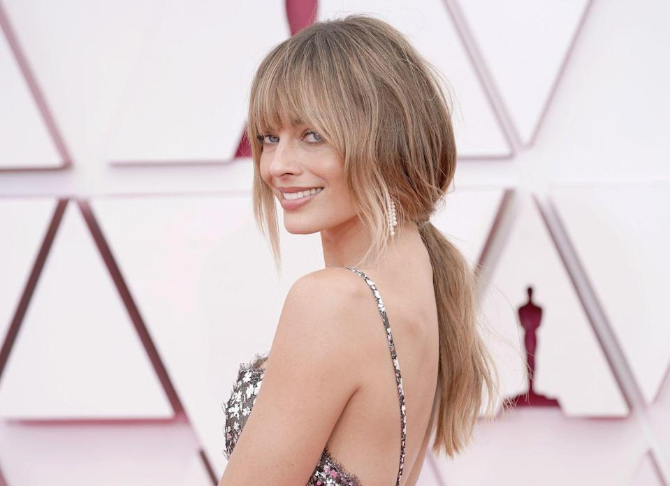 <p>Talk about a moment: Margot Robbie's bangs debut at the Oscars were awards-worthy themselves. The face-framing pieces at the sides are lovely with her square-shaped face, too.</p>