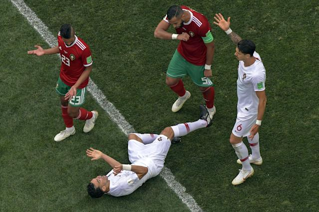 Portugal's defender Pepe, preparing to leap to his feet after going down in the group game against Morocco.