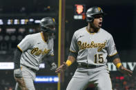 Pittsburgh Pirates' Adam Frazier, left, and Wilmer Difo (15) celebrate after both scored against the San Francisco Giants during the seventh inning of a baseball game in San Francisco, Friday, July 23, 2021. (AP Photo/Jeff Chiu)