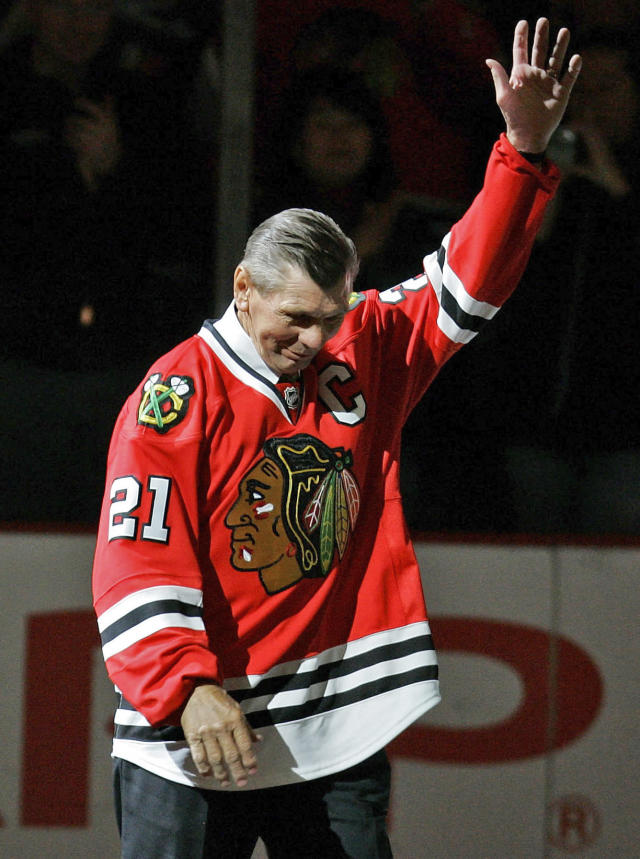 FILE - In this March 7, 2008, file photo, Chicago Blackhawks great Stan Mikita waves to fans as they as he is introduced before an NHL hockey game against the San Jose Sharks in Chicago. Mikita, who played for the Blackhawks for 22 seasons, becoming one of the franchise's most revered figures, has died, the Blackhawks announced Tuesday, Aug. 7, 2018. He was 78. (AP Photo/Brian Kersey, File)