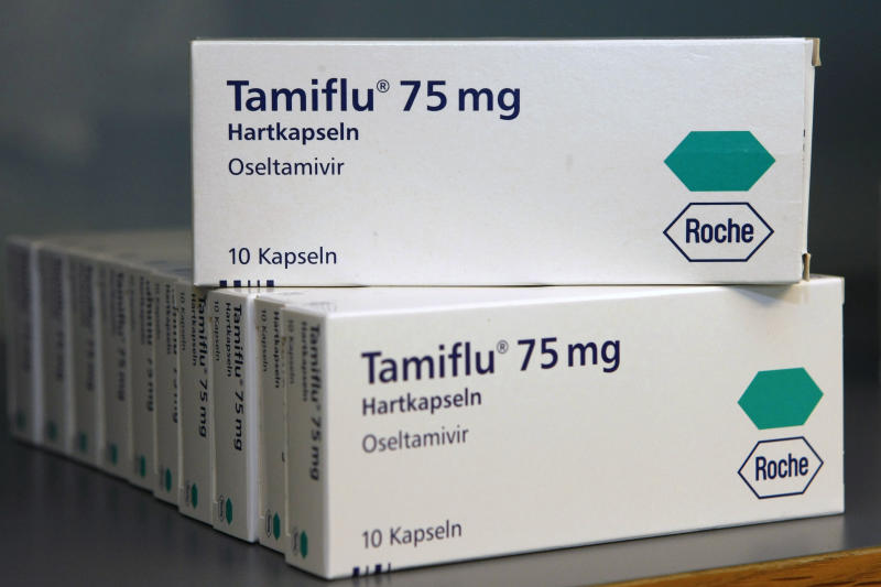FILE - In this April 28, 2009 file photo packages of the medicine Tamiflu by Swiss pharmaceutical company Roche are seen in Stuttgart, southern Germany. A leading British medical journal is asking the drug maker Roche to release all its data on Tamiflu, claiming there is no evidence the drug can actually stop the flu. The drug has been stockpiled by dozens of governments worldwide in case of a global flu outbreak and was widely used during the 2009 swine flu pandemic. On Monday Nov. 12, 2012, one of the researchers linked to the BMJ called for European governments to sue Roche. (AP Photo/Thomas Kienzle, File)