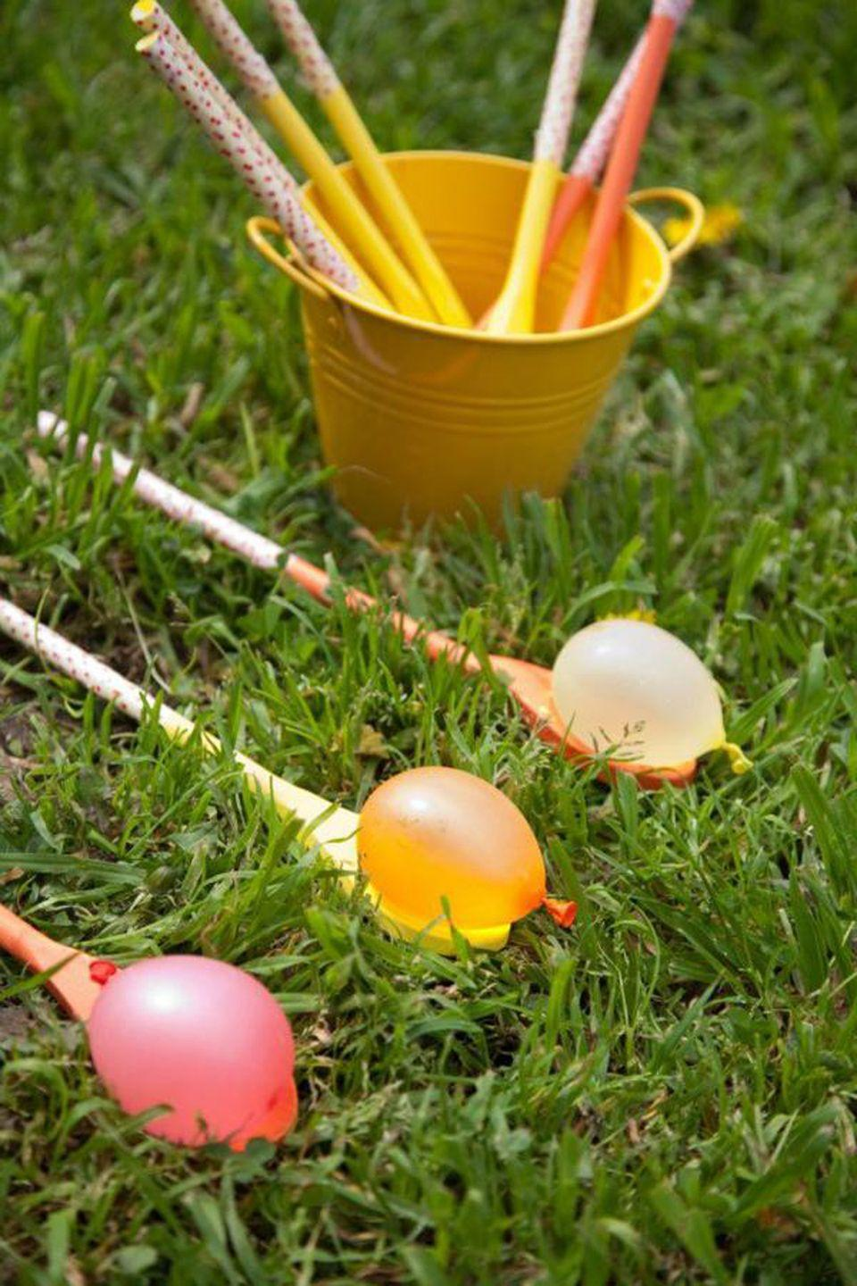 "<p>Customize this activity for the weather on your holiday—you can host a classic race with real or plastic eggs, or use tiny water balloons if it's warm enough outside. </p><p><strong>Get the tutorial at <a href=""http://karaspartyideas.com/2013/03/gender-neutral-spring-soiree-1st-birthday-party.html"" rel=""nofollow noopener"" target=""_blank"" data-ylk=""slk:Kara's Party Ideas"" class=""link rapid-noclick-resp"">Kara's Party Ideas</a>.</strong></p>"