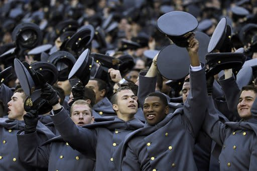Army Cadets cheer before the kickoff of an NCAA college football game against Navy, Saturday, Dec. 8, 2012, in Philadelphia. (AP Photo/Matt Slocum)
