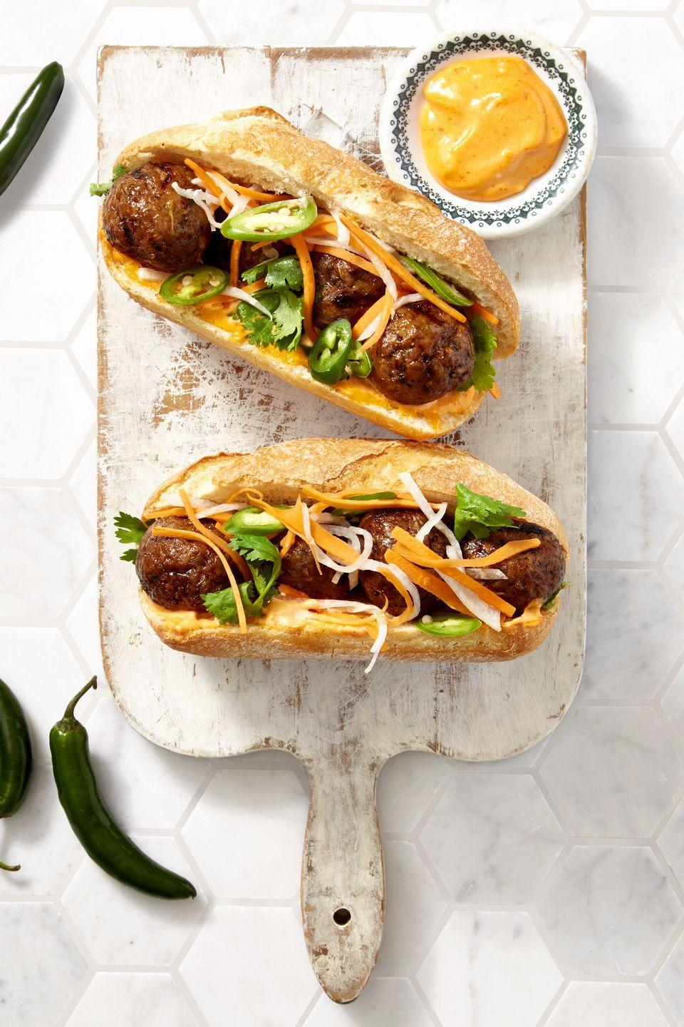 "<p>Ground pork makes for more flavorful, tender meatballs than just beef alone. Add some mint, lemongrass, fish sauce and Sriracha to the mix to really make your taste buds do a little dance.</p><p><a href=""https://www.goodhousekeeping.com/food-recipes/a39934/sriracha-meatball-hoagies-recipe/"" rel=""nofollow noopener"" target=""_blank"" data-ylk=""slk:Get the recipe for Sriracha Meatball Hoagies »"" class=""link rapid-noclick-resp""><em>Get the recipe for Sriracha Meatball Hoagies »</em></a></p>"