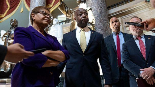 PHOTO: Rep. Karen Bass, Sen. Tim Scott, Sen. Cory Booker, and Rep. Josh Gottheimer speak briefly to reporters following a meeting about police reform legislation on Capitol Hill, May 18, 2021, in Washington. (Drew Angerer/Getty Images, FILE)
