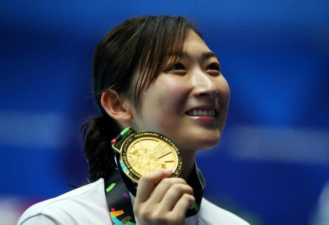FILE PHOTO: Swimming - 2018 Asian Games - Women's 50m Freestyle