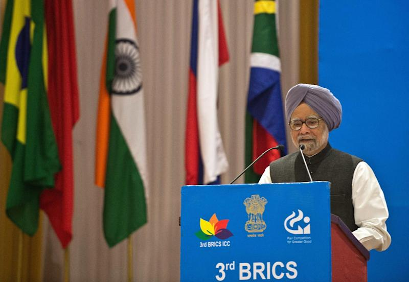 Indian Prime Minister Manmohan Singh delivers a speech during the inauguration of the 3rd BRICS International Competition Conference in New Delhi on November 21, 2013 (AFP Photo/Prakash Singh)