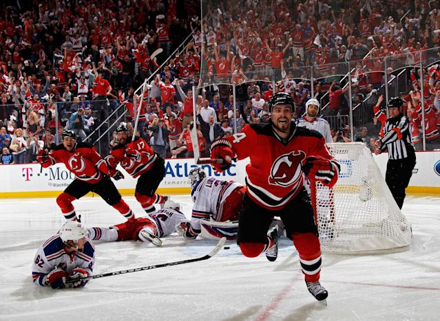 EWARK, NJ - MAY 25: Adam Henrique #14 of the New Jersey Devils celerbates after scoring the game winning goal in overtime against Henrik Lundqvist #30 of the New York Rangers to win Game Six of the Eastern Conference Final and advance to the 2012 NHL Stanley Cup Final at the Prudential Center on May 25, 2012 in Newark, New Jersey. (Photo by Bruce Bennett/Getty Images)