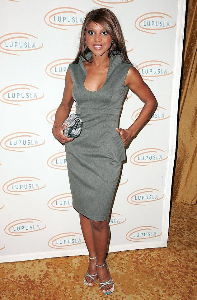 """Her decision to compete on """"Dancing With the Stars"""" is still up for debate, but there's no denying the beauty of Toni Braxton's gray sleeveless collared cocktail frock and strappy sandals. Jason LaVeris/<a href=""""http://www.filmmagic.com/"""" target=""""new"""">FilmMagic.com</a> - November 7, 2008"""