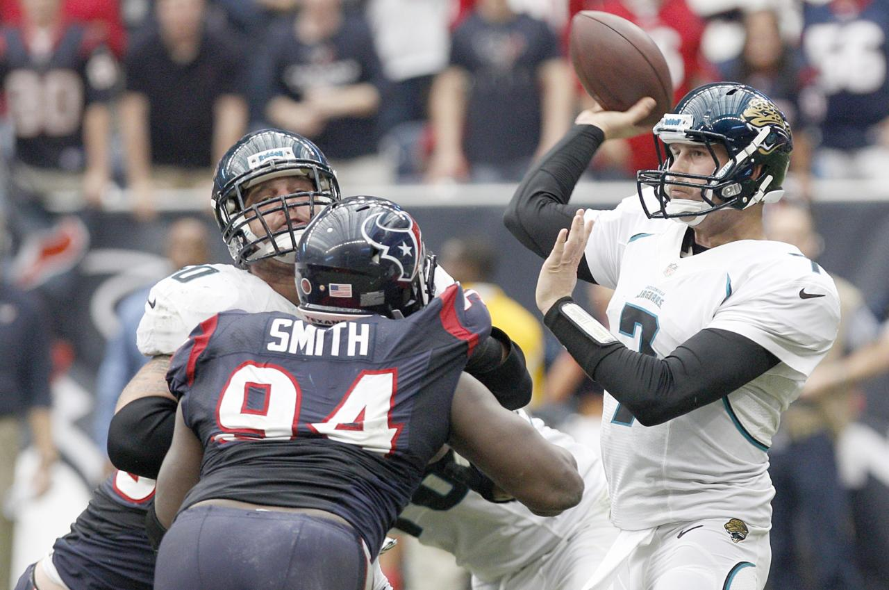 HOUSTON, TX- NOVEMBER 18: Chad Henne #7 of the Jacksonville Jaguars looks to pass in the pocket against the Houston Texans on November 18, 2012 at Reliant Stadium in Houston, Texas. Texans won 43 to 37 in overtime. (Photo by Thomas B. Shea/Getty Images)