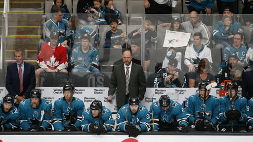 San Jose Sharks head coach Peter DeBoer watches the game from the bench against the Calgary Flames in the second period of an NHL hockey game in San Jose, Calif., Sunday, March 31, 2019. (AP Photo/Josie Lepe)