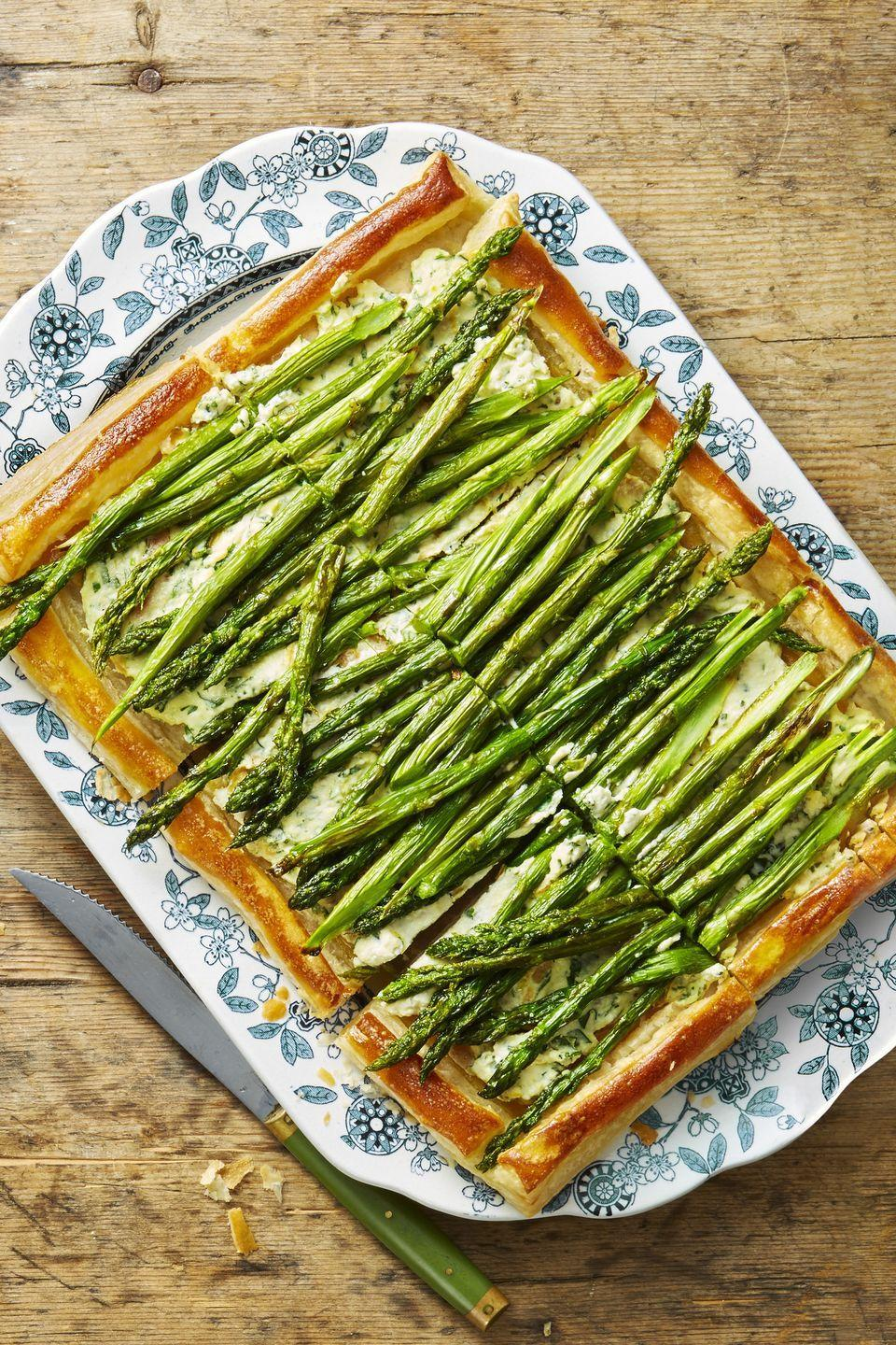 """<p>The easiest (and tastiest) way to get your filling of veggies at the holiday feast. </p><p><em><a href=""""https://www.goodhousekeeping.com/food-recipes/a48174/roasted-asparagus-and-ricotta-tart-recipe/"""" rel=""""nofollow noopener"""" target=""""_blank"""" data-ylk=""""slk:Get the recipe for Roasted Asparagus and Ricotta Tart »"""" class=""""link rapid-noclick-resp"""">Get the recipe for Roasted Asparagus and Ricotta Tart »</a></em></p>"""
