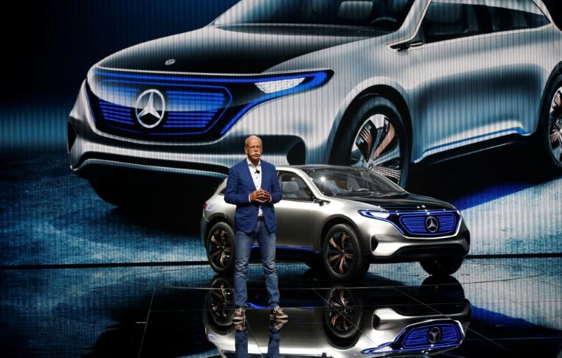 Dieter Zetsche, CEO of Daimler and Head of Mercedes-Benz, attends a news conference in front of a Mercedes EQ Electric car on media day at the Mondial de l'Automobile in Paris
