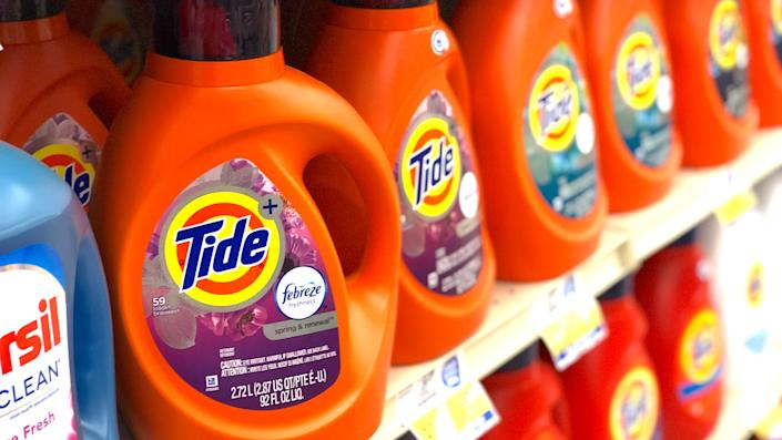 Harlan, KY / USA - July 17, 2019: Tide brand detergent with added Febreze freshener in plastic bottles on the shelf at a local grocery store.