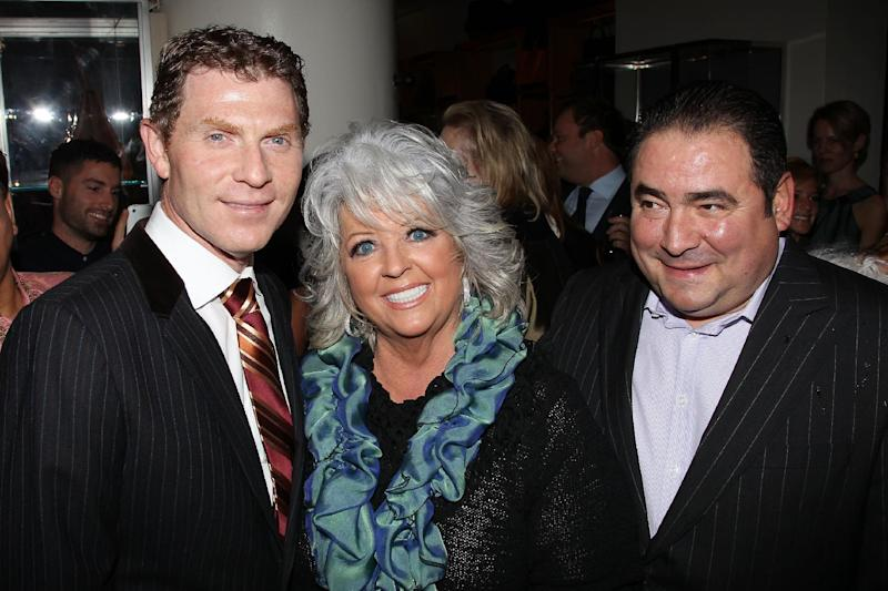 "FILE - In this Nov. 16, 2010 file photo provided by StarPix, from left to right, celebrity chefs Bobby Flay, Paula Deen, and Emeril Lagasse from the Food Network attend the unveiling of Barneys New York food themed holiday windows in New York. It was revealed that Deen admitted during questioning in a lawsuit that she had slurred blacks in the past. It's the second time the queen of comfort food's mouth has gotten her into big trouble. She revealed in 2012 that for three years she hid her Type 2 diabetes while continuing to cook the calorie-laden food that's bad for people like her. The Food Network, which began airing ""Paula's Home Cooking"" in 2002, has said it does not tolerate discrimination and is looking at the situation. (AP Photo/Marion Curtis, StarPix, file)"