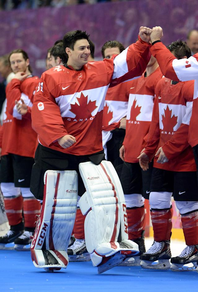 SOCHI, RUSSIA - FEBRUARY 23: Goalie Carey Price #31 of Canada celebrates his team's 3-0 victory with teammates during the Men's Ice Hockey Gold Medal match on Day 16 of the 2014 Sochi Winter Olympics at Bolshoy Ice Dome on February 23, 2014 in Sochi, Russia. (Photo by Harry How/Getty Images)